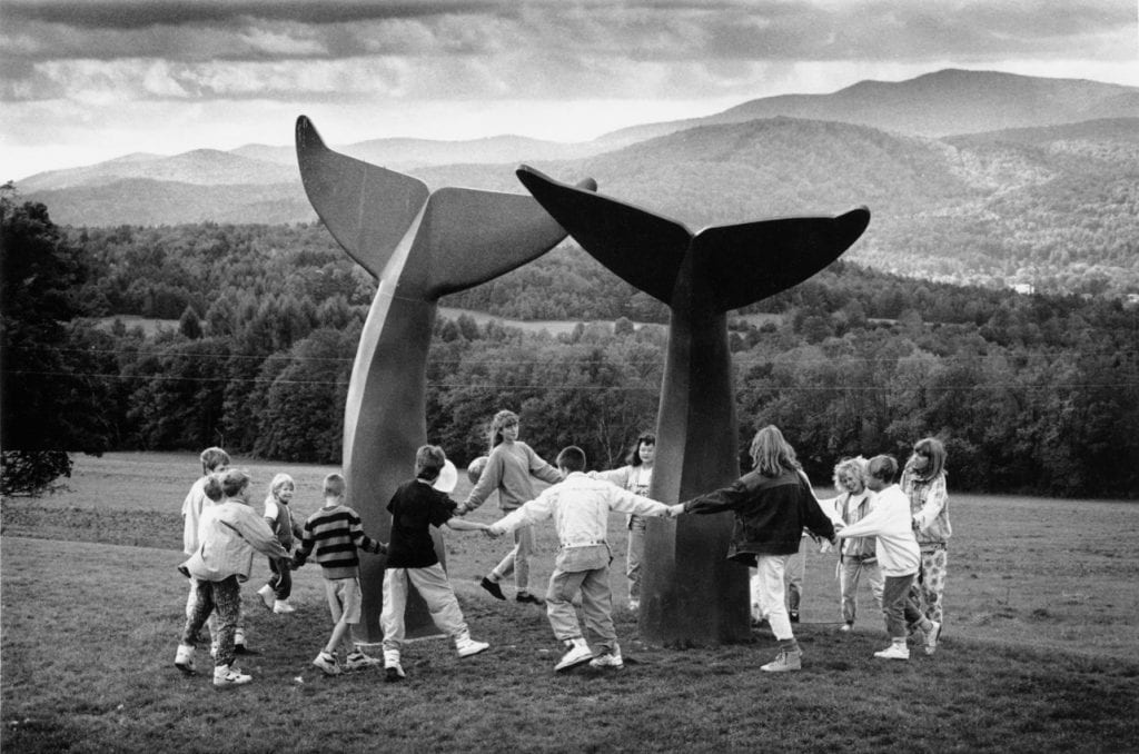 "A group of kids dances around Sardonis' sculpture ""Reverence"" in this 1991 photo. (Herald File / Bob Eddy)"