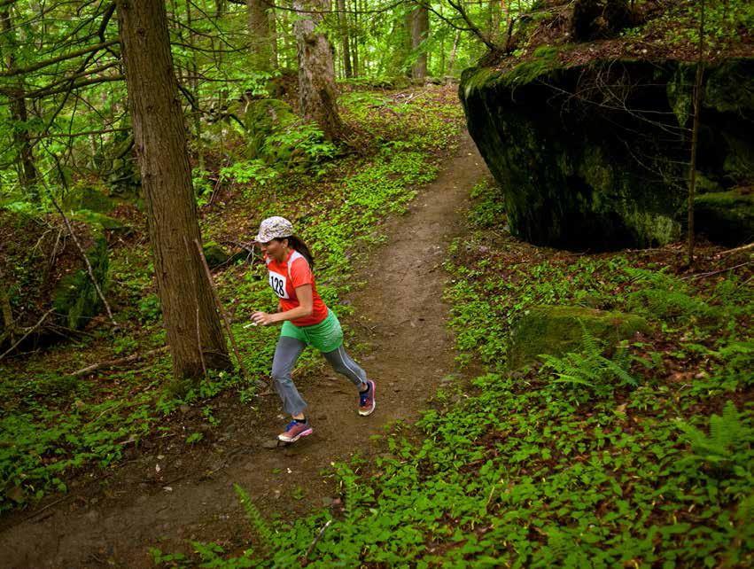 Manzanita Sanz of Rochester runs the 5K on the new wilderness trails behind the Rochester ranger station. (Herald / Seth Butler)