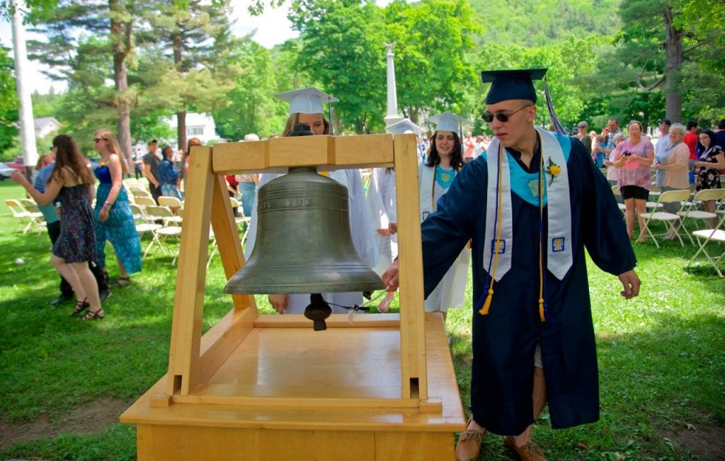 June New Rochester HS graduate Daniel Labejsza stops to do the traditional tolling of the old school bell following the high school's final graduation on the park in Rochester. (Herald / Jerry LeBlond)