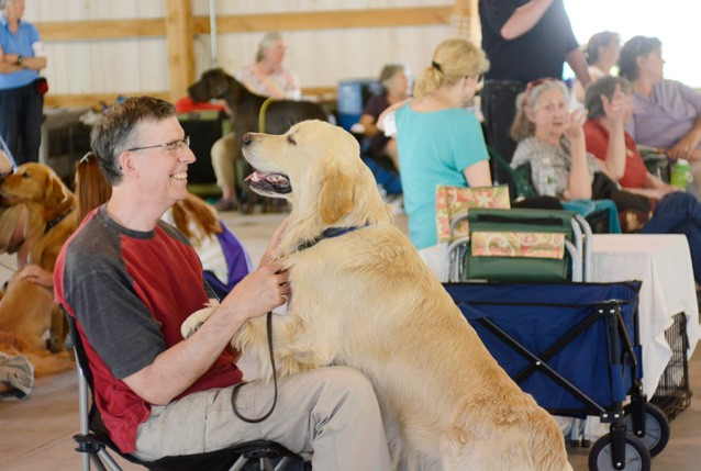 July Craig Greene of Hopkinton, N.H. shares a smile with his dog Rhys during the Vermont Scenic Dog Show at the Tunbridge Fairground. (Herald / Emily Ballou)