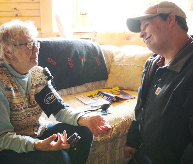 October First Branch Ambulance EMT Ryan Malone checks the blood pressure of Tunbridge resident Hazel Welch during their weekly house call. (Herald / Dylan Kelley)