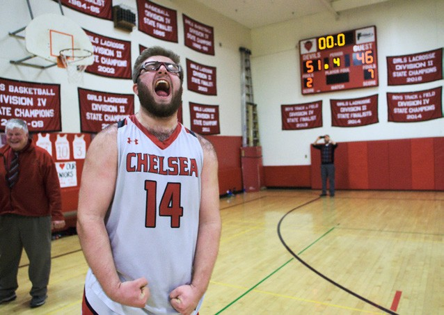 February Chelsea junior Ronald Johnson celebrates his last victory on the basketball court as a Red Devil. (Herald / Dylan Kelley)