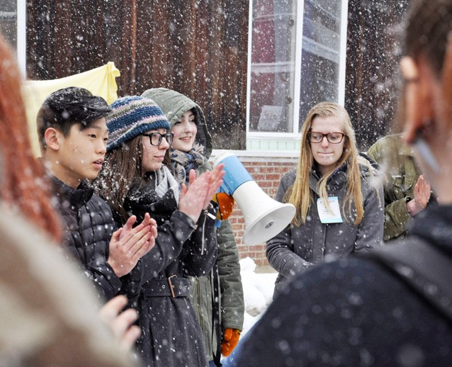 March Lukina Andreyev addresses a crowd of students with Elissa Doering, Branden Ryan, and Amanda Rosalbo at a Randolph Union High School walkout in response to a school shooting in Florida. (Herald / Ethan Johnson)