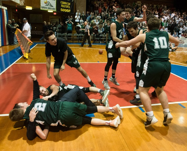 March The Phoenix boys tackle coach Blake Fabricant in celebration as the Sharon Academy won the first state championship in the school's history, outdoing number-one-ranked Danville at the Barre Aud to take the D-IV boys basketball title. (Herald / Tim Calabro)