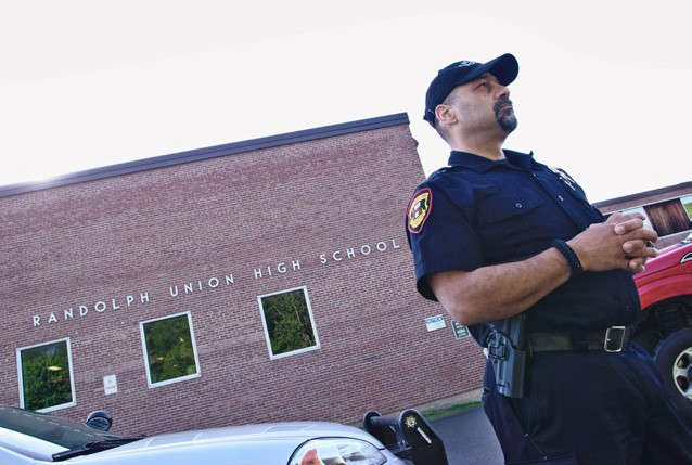 May Former Randolph Chief of Police Daniel Brunelle monitors the morning arrival period at Randolph Union High School the day after a shooting threat closed Randolph area schools. (Herald / Dylan Kelley)
